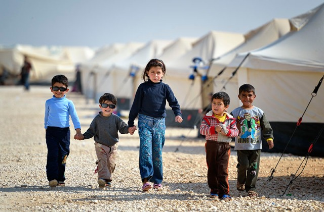 Children walking in the Zaatari Refugee Camp, located near Mafraq, Jordan. Opened in July, 2012, the camp holds upwards of 20,000 refugees from the civil war inside Syria. International Orthodox Christian Charities and other members of the ACT Alliance are active in the camp providing essential items and services.